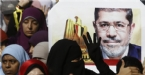 "Egypt court postpones Morsi's ""killing protesters"" trial"