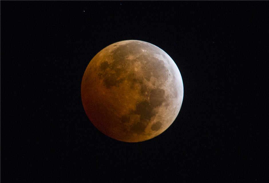 Rare blood moon rise above the world