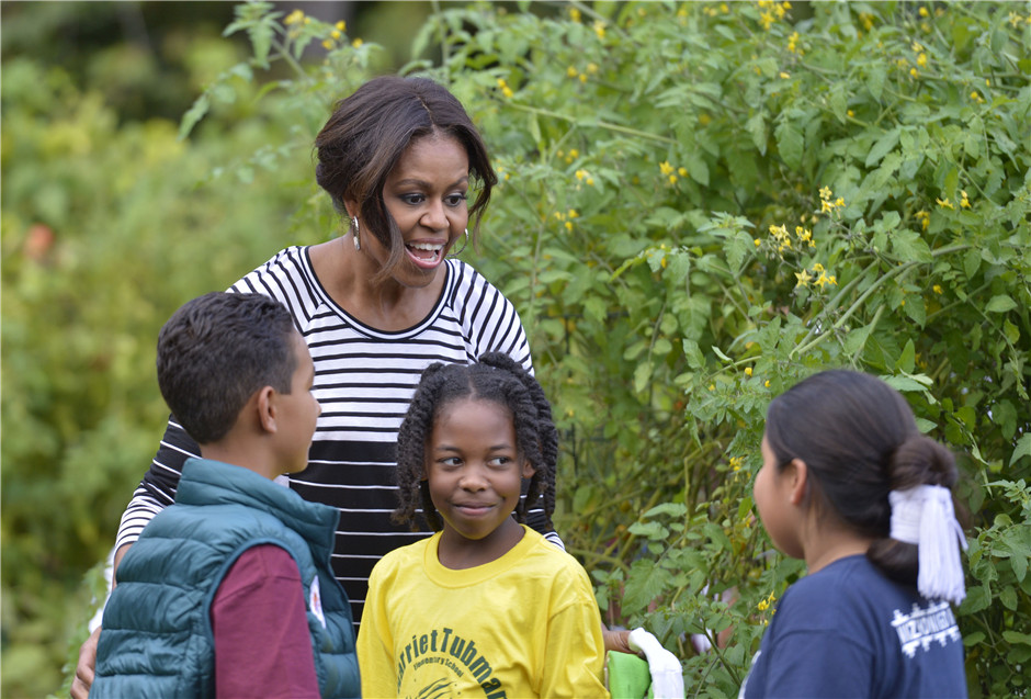 U.S. First Lady Michelle Obama picks vegetables at White House Garden