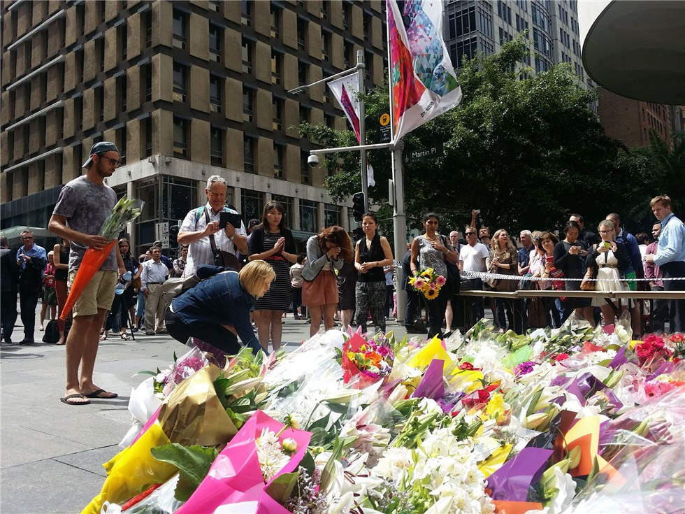 Sydney mourns the three Cafe siege victims