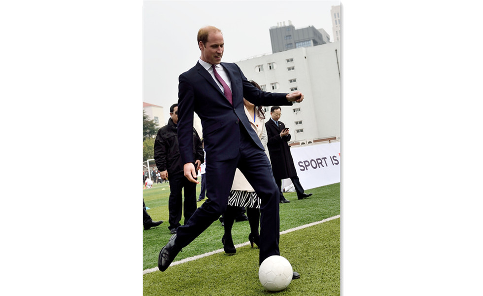 Prince William shows his ball skill in Shanghai, China
