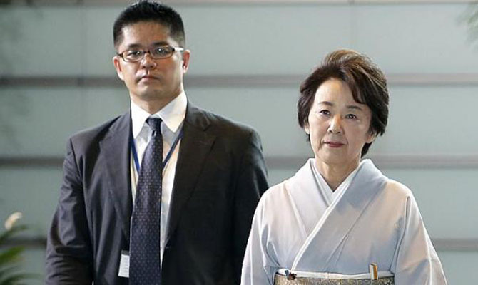 Japanese minister visits notorious shrine despite neighbors' concern