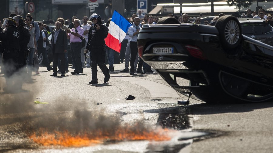 At least eight arrested amid violent taxi protests against Uber in France