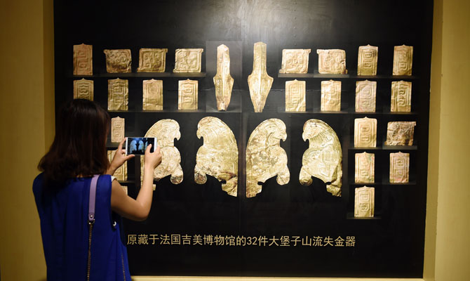 France returns gold artifacts to Chinese museum